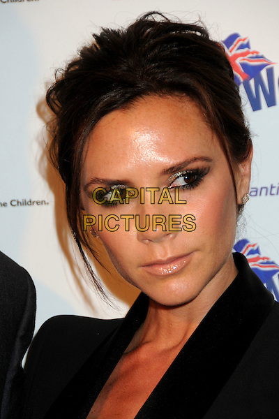 "VICTORIA BECKHAM .BritWeek 2010 Charity Event: ""Save The Children and Virgin Unite"" held at the Beverly Wilshire Hotel, Beverly Hills, California, USA, 22nd April 2010..portrait headshot black hair up make-up earrings diamond studs .CAP/ADM/BP.©Byron Purvis/AdMedia/Capital Pictures."