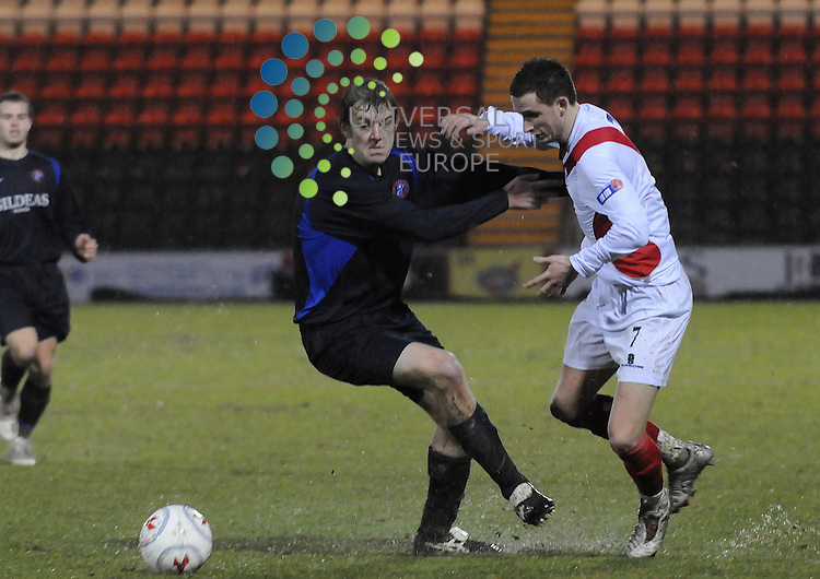 Airdrie United v Spartans.Homecoming Scottish Cup 4th Round.10th Jan 2009 - Excelsior Stadium..Airdrie's Steven McDougall battles with Spartan's defender Danny O'Donnell during this afternoons cup tie...Picture by Steven Carrie.