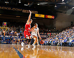 BROOKINGS, SD - JANUARY 17:  Madison Guebert #11 from South Dakota State tries to get a step past Bridget Arens #22 from the University of South Dakota in the first half of their game Sunday afternoon at Frost Arena in Brookings, S.D. (Photo by Dave Eggen/Inertia)