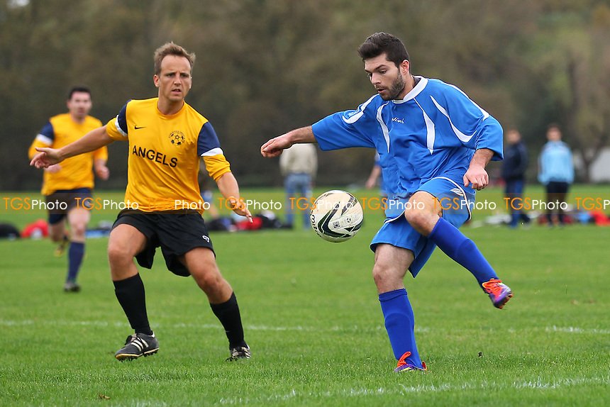 Riviera (blue) vs Athletico Angels - Hackney & Leyton Sunday League Football at South Marsh, Hackney , London - 26/10/14 - MANDATORY CREDIT: Gavin Ellis/TGSPHOTO - Self billing applies where appropriate - contact@tgsphoto.co.uk - NO UNPAID USE