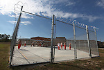 """Three Forks Regional Jail is no small part of life in the country-side community it calls home in the Eastern Kentucky mountains. Currently housing over 220 inmates, almost everyone in Beattyville, and the surrounding counties, either knows someone in the jail, has worked for the jail or has served time. """"There's not much to do here [ in Beattyville],"""" said jail officer Michellle Dunaway. """"A lot of people get bored, get into the wrong things and wind up in jail. It's hard to get out of.""""..Male inmates enjoy recreational time at the jail on Thursday, Sept. 30, 2010. .Photo by Britney McIntosh"""