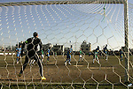 Players from Rafah Youth Club play against the players from Rafah Services Club during a football match in the league of the Gaza Strip at Rafah Municipality Stadium in the southern Gaza Strip on January 21, 2011. Photo by Abed Rahim Khatib