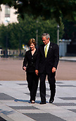 Washington, D.C. - July 9, 2007 -- United States President George W. Bush and First Lady Laura Bush walk from the White House across Pennsylvania Ave. to Blair House for a farewell party for Dan Bartlett, Counselor to the President, Monday, July 9, 2007.<br /> Credit: Martin H. Simon - Pool via CNP