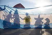 MOSCOW, RUSSIA - June 16, 2018: Fans are silouhetted by an Argentina flag  at the FIFA Fan Fest at Vorobyovy Gory (Sparrow Hills) during the 2018 FIFA World Cup.