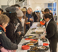 Visitors to Hostos community College in the Bronx in New York partake in samples of African food during the Bronx: Africa exhibit on Wednesday, April 6, 2016.  (© Richard B. Levine)