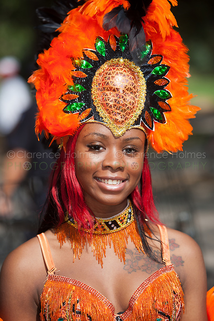 A parade participant in festive attire at the West Indian American Day Parade held on Monday, September 5, 2011 in Crown Heights, Brooklyn, New York.  The annual Labor Day event, which runs along Eastern Parkway, celebrates West Indian heritage and attracts 2-3 million spectators.