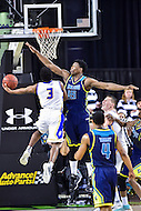 MAR 7, 2016: Baltimore, MD - Hofstra Pride guard Justin Wright-Foreman (3) goes up for a lay up defended by North Carolina-Wilmington Seahawks forward Devontae Cacok (15) during the Championship game of the CAA Basketball Tournament at Royal Farms Arena in Baltimore, Maryland. (Photo by Philip Peters/Media Images International)