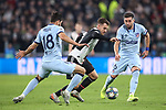 Aaron Ramsey of Juventus takes on Felipe of Atletico Madrid and Hector Herrera during the UEFA Champions League match at Juventus Stadium, Turin. Picture date: 26th November 2019. Picture credit should read: Jonathan Moscrop/Sportimage