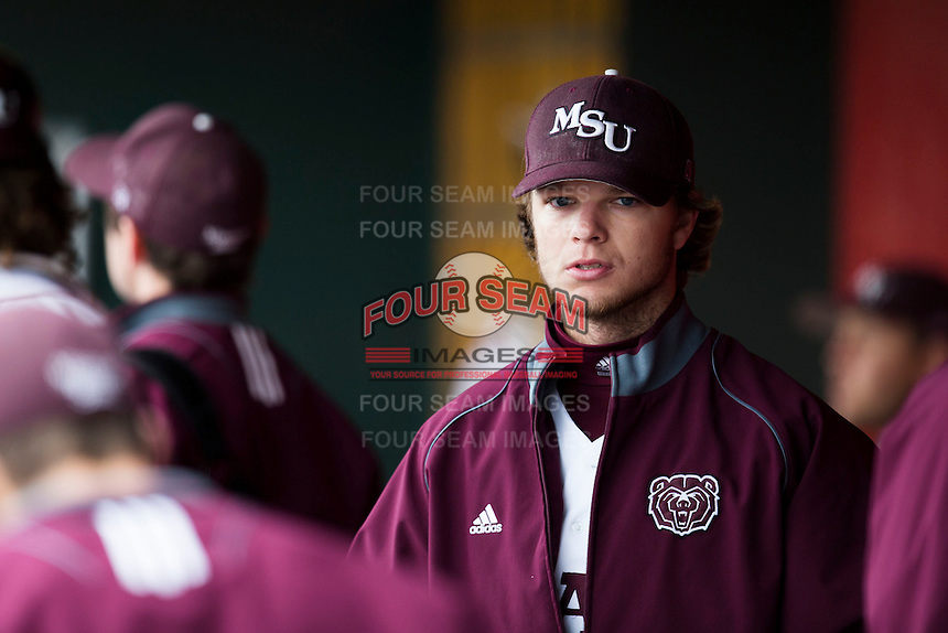 Nick Petree #10 of the Missouri State Bears stands in the dugout during a game against the Wichita State Shockers at Hammons Field on May 4, 2013 in Springfield, Missouri. (David Welker/Four Seam Images)