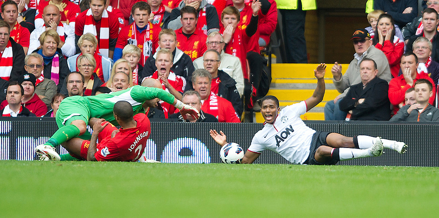 Manchester United's Luis Antonio Valencia is fouled by Liverpool's Glen Johnson conceding a penalty scored by Robin van Persie to give his team a 2-1 victory..Football - Barclays Premiership - Liverpool v Manchester United - Sunday 23rd September 2012 - Anfield - Liverpool..