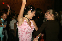 (L-R) Anna Bessonova and Irina Kovalchuk of Ukraine dance during banquet after World Championships at Baku, Azerbaijan on October 9, 2005. Bessonova won silver in All-Around and Kovalchuk competed during team competition. (Photo by Tom Theobald)