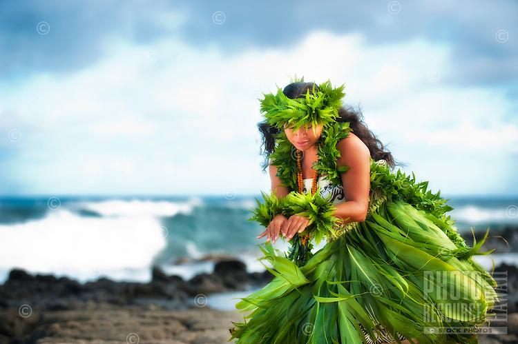Hula kahiko dancer in ti leaf skirt at Sandy Beach, East O'ahu.