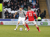 Paul Dummett being closed down by Jonny Hayes in the St Mirren v Aberdeen Clydesdale Bank Scottish Premier League match played at St Mirren Park, Paisley on 9.11.12.