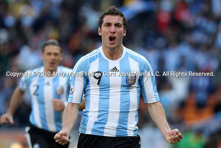 17 JUN 2010: Gonzalo Higuain (ARG) celebrates his first goal. The Argentina National Team defeated the South Korea National Team 4-1 at Soccer City Stadium in Johannesburg, South Africa in a 2010 FIFA World Cup Group E match.