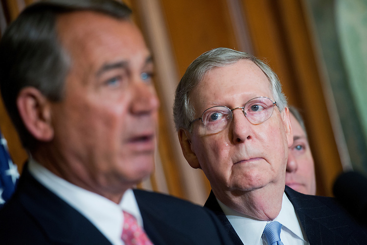 """UNITED STATES - APRIL 16: Senate Majority Leader Mitch McConnell, R-Ky., right, looks on as Speaker John Boehner, R-Ohio, makes remarks during a signing ceremony in the Capitol's Rayburn Room for a bipartisan bill to """"strengthen Medicare and fix its payment formula for doctors,"""" April 16, 2015. (Photo By Tom Williams/CQ Roll Call)"""