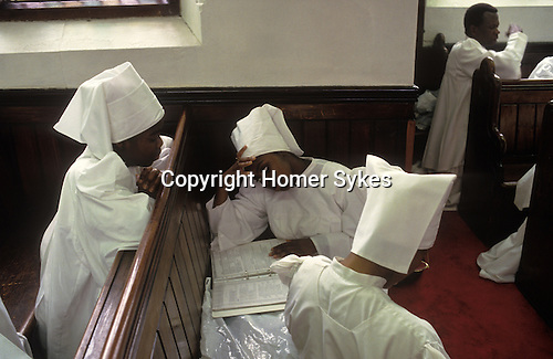 Brotherhood of the Cross and Star south London. The Sunday service day of prayer children look at Bible study work. from A STORM IS PASSING OVER a Look at Black Churches in Britain. Published by Thames and Hudson isbn 0 500 27826 1