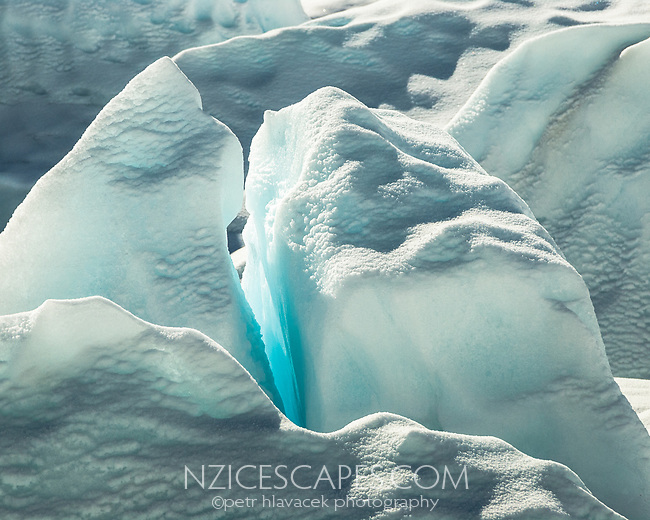 Close up of backlit ice on Franz Josef Glacier, Westland Tai Poutini National Park, West Coast, UNESCO World Heritage Area, New Zealand, NZ