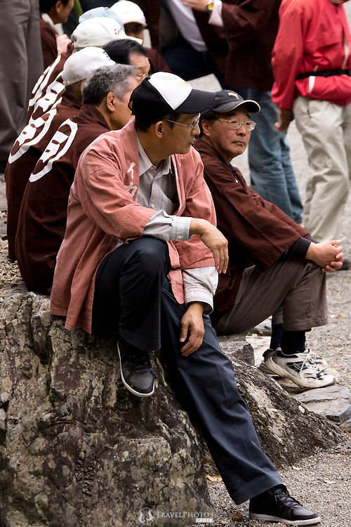 Team members rest for a moment at the Tado Horse Festival.