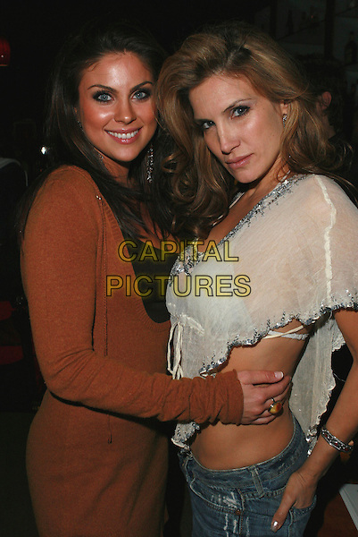 "NADIA BJORLIN & KAMILLA BJORLIN.Redline Premiere Party, ""Myspace For Myfriends"" held at Aura Nightclub, Studio City, California, USA.  .April 18th, 2007.half length brown dress white top arms around waist  .CAP/ADM/CH.©Charles Harris/AdMedia/Capital Pictures"