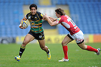 Ken Pisi of Northampton Saints forces his way past Tom Arscott of London Welsh during the Aviva Premiership match between London Welsh and Northampton Saints at the Kassam Stadium on Sunday 14th April 2013 (Photo by Rob Munro)