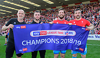 Lincoln City's first team goalkeeping coach Andy Warrington, left, Grant Smith, Josh Vickers and Matt Gilks celebrate after winning the league<br /> <br /> Photographer Chris Vaughan/CameraSport<br /> <br /> The EFL Sky Bet League Two - Lincoln City v Tranmere Rovers - Monday 22nd April 2019 - Sincil Bank - Lincoln<br /> <br /> World Copyright © 2019 CameraSport. All rights reserved. 43 Linden Ave. Countesthorpe. Leicester. England. LE8 5PG - Tel: +44 (0) 116 277 4147 - admin@camerasport.com - www.camerasport.com