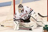 Clay Witt (NU - 31) - The visiting University of Vermont Catamounts defeated the Northeastern University Huskies 6-2 on Saturday, October 11, 2014, at Matthews Arena in Boston, Massachusetts.
