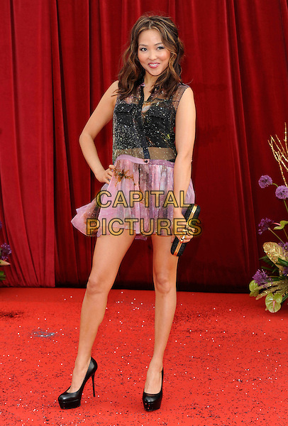ELIZABETH TAN .At the British Soap Awards 2011, Granada TV Studios, Manchester, England, UK, MaY 14th 2011..arrivals full length  black  pink sheer print sleeveless shirt dress shoes heels hand on hip buttons  .CAP/DH.©David Hitchens/Capital Pictures.