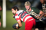 Andrew West looks for options as Stephen Briscoe prepares to make the tackle. Counties Manukau Premier Club Rugby game between Karaka and Manurewa, played at Karaka, on Saturday June 14 2014. Karaka won the game 63- 24 after leading 32 - 10 at halftime  Photo by Richard Spranger