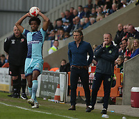 Sido Jombati  (L)of Wycombe Wanderers  throws the ball in as Gareth Ainsworth (Manager) (C) and Richard Dobson<br /> (Assistant manager ) (R) look on during the Sky Bet League 2 match between Morecambe and Wycombe Wanderers at the Globe Arena, Morecambe, England on 29 April 2017. Photo by Stephen Gaunt / PRiME Media Images.