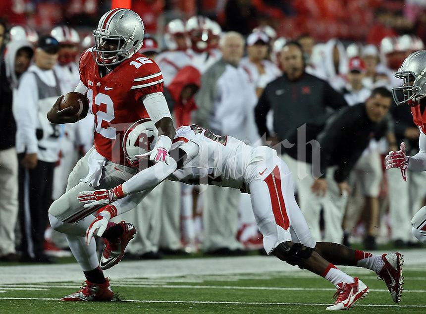 Ohio State Buckeyes quarterback Cardale Jones (12) is able to gain yards in the fourth quarter of their game at Ohio Stadium in Columbus, Ohio on October 18, 2014. (Columbus Dispatch photo by Brooke LaValley)