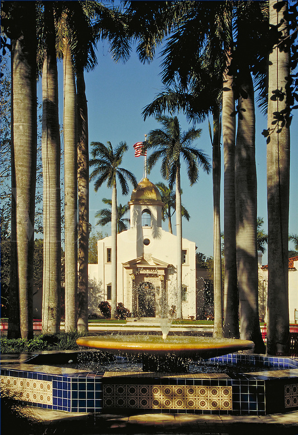 Historic Boca Raton Town Hall, designed by architect Addison Mizner and built in 1927, seen from Sanborn Square. urban design, ornamental architecture, landmarks, fountain, Moorish influence. Boca Raton Florida, Sanborn Square.