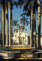 Historic Boca Raton Town Hall, designed by architect Addison Mizner and built in 1927, seen from Sanborn Square. urban design, ornamental architecture, landmarks, fountain, Moorish influence. Boca Raton Florida, Sanborn Square.