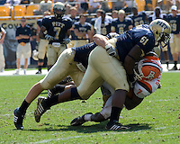 Pitt linebacker Scott McKillop and defensive lineman Tommie Duhart (#51) bring down Bowling Green running back Anthony Turner (#17).  The Bowling Green Falcons defeated the Pitt Panthers 27-17 on August 30, 2008 at Heinz Field, Pittsburgh, Pennsylvania.