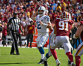 Indianapolis Colts quarterback Andrew Luck (12) looks for a receiver in fourth quarter action against the Washington Redskins at FedEx Field in Landover, Maryland on Sunday, September 16, 2018.  Washington Redskins linebacker Ryan Kerrigan (91) defends on the play. The Colts won the game 21 - 9.<br />