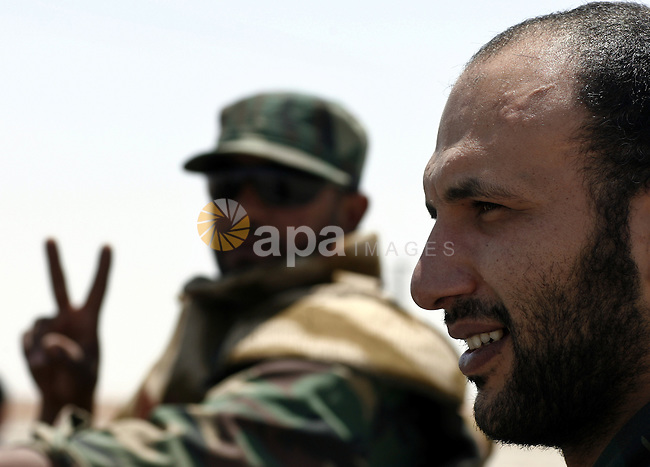 Libyan rebel fighters head towards the front line outside the Libyan eastern city Ajdabiya on May 10, 2011, where fighting between rebels and forces loyal to leader Moamer Kadhafi is ongoing. Photo by Wissam Nassar