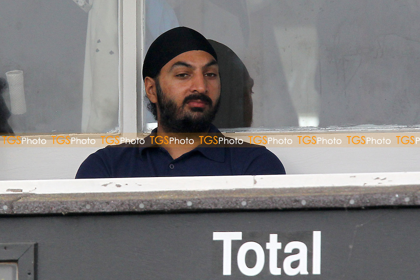 New Essex signing Monty Panesar looks on from the pavilion as rain continues to fall and delays play on Day Three - Essex CCC vs Northamptonshire CCC - LV County Championship Division Two Cricket at Castle Park, Colchester Cricket Club - 22/08/13 - MANDATORY CREDIT: Gavin Ellis/TGSPHOTO - Self billing applies where appropriate - 0845 094 6026 - contact@tgsphoto.co.uk - NO UNPAID USE
