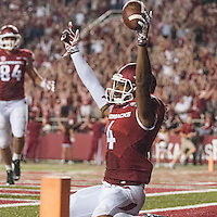 STAFF PHOTO ANTHONY REYES • @NWATONYR<br /> Keon Hatcher Arkansas wide receiver, celebrates a fourth quarter touchdown against Northern Illinois University Saturday, Sept. 20, 2014 at Razorback Stadium in Fayetteville. The Razorbacks won 52-14.