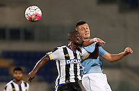 Calcio, Serie A: Lazio vs Udinese. Roma, stadio Olimpico, 13 settembre 2015.<br /> Udinese's Emmanuel Badu, left, and Lazio&rsquo;s Sergej Milinkovic-Savic jump for the ball during the Italian Serie A football match between Lazio and Udinese at Rome's Olympic stadium, 13 September 2015.<br /> UPDATE IMAGES PRESS/Isabella Bonotto