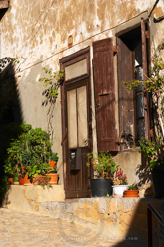 Gruissan village. La Clape. Languedoc. A door. Window. Village street. France. Europe.