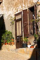 Gruissan village. La Clape. Languedoc. A door. Window. Village street. France. Europe.