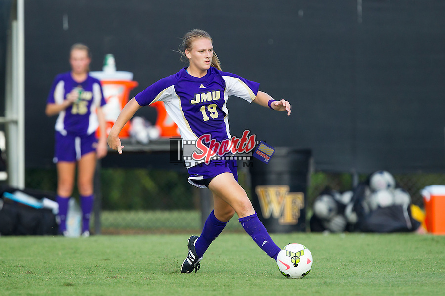 Ashley Herndon (19) of the James Madison Dukes passes the ball during first half action against the Wake Forest Demon Deacons at Spry Soccer Stadium on August 29, 2014 in Winston-Salem, North Carolina.  The Dukes defeated the Demon Deacons 2-1.   (Brian Westerholt/Sports On Film)