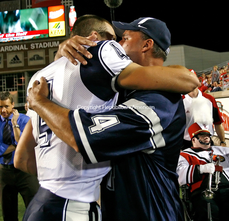 LOUISVILLE, KY, 09/26/08- 092608BZ01- UConn quarterback Tyler Lorenzen gets a hug from his father Jerry after leaving the game with an injury during the second half of their game against Louisville Friday night.<br /> Jamison C. Bazinet Republican-America