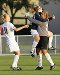 7 November 2007: Virginia teammates congratulate goalkeeper Chantel Jones (right) following the penalty kick shootout. The University of Virginia tied the University of Miami 0-0 at the Disney Wide World of Sports complex in Orlando, FL in an Atlantic Coast Conference tournament quarterfinal match.  Virginia advanced to the semifinals on penalty kicks, 4-2.