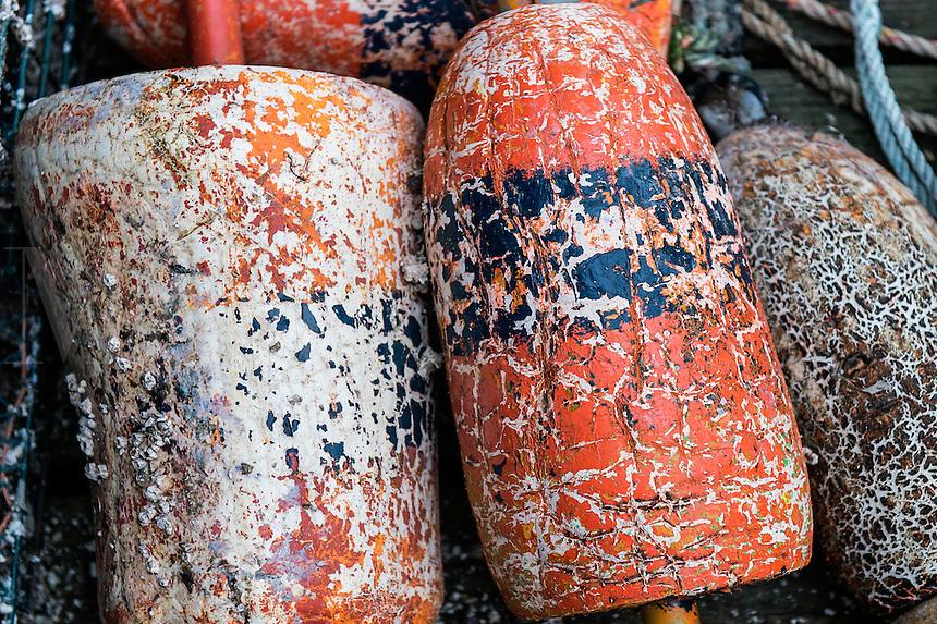 Weathered lobster buoys, Maine, USA
