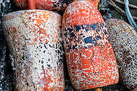 Weathered lobster buoys, Maine, USA