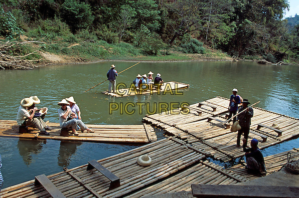 Tourists on bamboo rafts, Mae Ping River, Mae Ping, near Chiang Mai, Northern Thailand