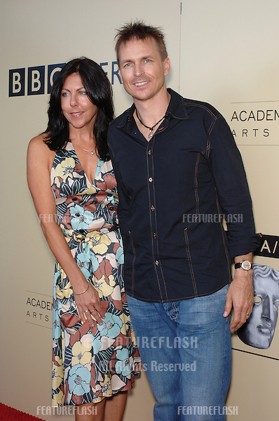 Amazing Race host PHIL KEOGHAN & date at the BAFTA/LA & Academy of TV Arts & Sciences 3rd Annual Tea Party honoring Emmy nominees..September 17, 2005  Los Angeles, CA..© 2005 Paul Smith / Featureflash