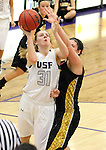 SIOUX FALLS, SD - DECEMBER 6:  Shelby Hemmann #31 from the University of Sioux Falls shoots the ball against Millie Niggeling #40 from Wayne State in the first half of their game Friday night at the Stewart Center. (Photo by Dave Eggen/Inertia)