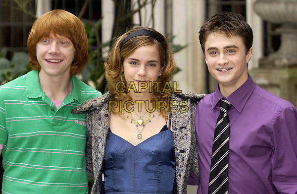 "RUPERT GRINT, EMMA WATSON & DANIEL RADCLIFFE.""Harry Potter & The Goblet of Fire"" Photocall at Merchant Taylor's Hall, London, UK..October 25th, 2005.Ref: FIN.headshot portrait green purple alice band.www.capitalpictures.com.sales@capitalpictures.com.© Capital Pictures."