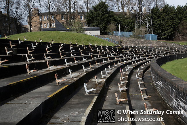 Edinburgh City v Spartans, 11/04/2015. Commonwealth Stadium, Scottish Lowland League. The disused terracing at the Commonwealth Stadium at Meadowbank before the Scottish Lowland League match between Edinburgh City and city rivals Spartans, which was won by the hosts by 2-0. Edinburgh City were the 2014-15 league champions and progressed to a play-off to decide whether there would be a club promoted to the Scottish League for the first time in its history. The Commonwealth Stadium hosted Scottish League matches between 1974-95 when Meadowbank Thistle played there. Photo by Colin McPherson.
